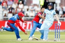 Gulbadin Naib jokingly tries to hold Eoin Morgan back as Najibullah Zadran runs in to field the ball, England v Afghanistan, World Cup 2019, Manchester, June 18, 2019
