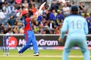 Gulbadin Naib goes on the attack as Eoin Morgan looks on, England v Afghanistan, World Cup 2019, Manchester, June 18, 2019