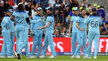 England celebrate after Gulbadin Naib is caught by Jos Buttler off Mark Wood's bowling
