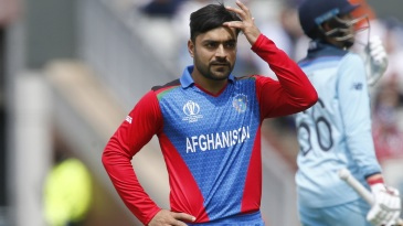 Rashid Khan looks on