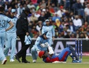 Jos Buttler checks on Hashmatullah Shahidi after he is struck by a Mark Wood bouncer, England v Afghanistan, World Cup 2019, Manchester, June 18, 2019
