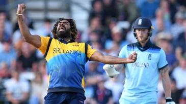 Lasith Malinga celebrates the wicket of Jos Buttler as Ben Stokes looks on