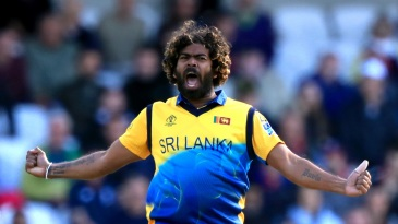 Lasith Malinga celebrates the wicket of Jos Buttler