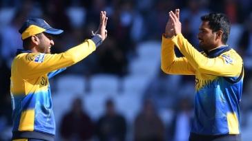 Dimuth Karunaratne and Dhananjaya de Silva celebrate the wicket of Moeen Ali