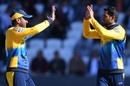Dimuth Karunaratne and Dhananjaya de Silva celebrate the wicket of Moeen Ali, World Cup 2019, Headingley, June 21, 2019