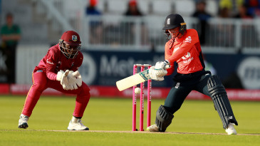 Danielle Wyatt cuts the ball to the boundary