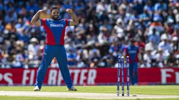 Gulbadin Naib with his signature celebration after dismissing Mohammed Shami