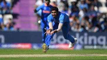 Jasprit Bumrah dives to catch Hashmatullah Shahidi off his own bowling