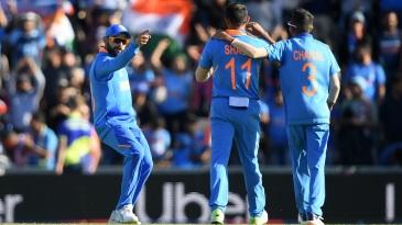 Virat Kohli congratulates Mohammed Shami after the all-important wicket of Mohammad Nabi