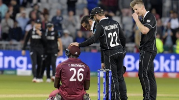 Carlos Brathwaite is consoled by Kane Williamson and Ross Taylor after getting caught on the boundary