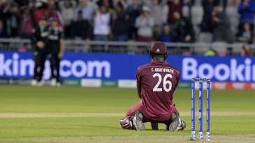 Carlos Brathwaite sinks to his knees after getting caught on the boundary