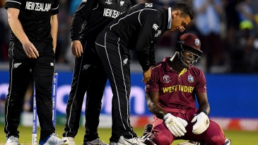 Carlos Brathwaite is consoled by Ross Taylor