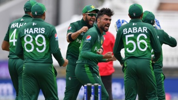 Mohammad Amir celebrates with his teammates after dismissing Hashim Amla