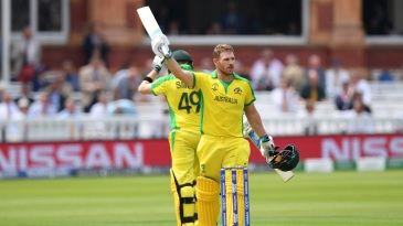 Aaron Finch celebrates his century