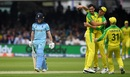 Mitchell Starc celebrates with teammates as Eoin Morgan walks back, England v Australia, World Cup 2019, Lord's, June 25, 2019