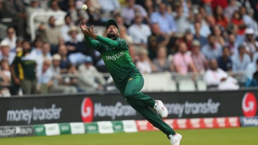 Mohammad Amir makes a valiant attempt to leap for a catch