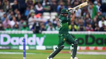 Babar Azam drives one away
