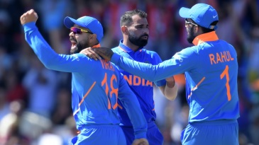 Mohammed Shami celebrates with captain Virat Kohli and KL Rahul after dismissing Chris Gayle