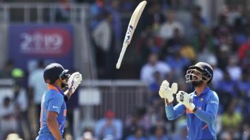Virat Kohli tosses the bat to KL Rahul