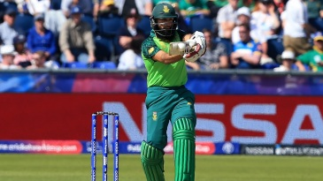 Hashim Amla plays a pull shot on course to his fifty