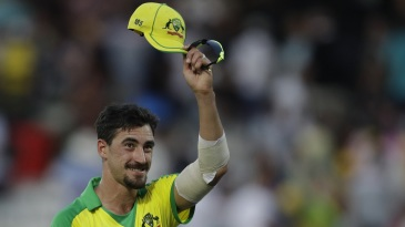 Mitchell Starc raises his cap to the crowd