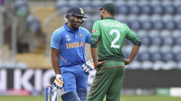 All smiles - Mashrafe Mortaza catches up with Rohit Sharma during the warm-up match