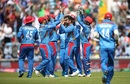 Rashid Khan celebrates dismissing Evin Lewis with his teammates, Afghanistan v West Indies. World Cup 2019, Headingley, July 4, 2019