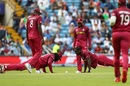 Chris Gayle and Carlos Bratwaite do push-ups to celebrate Rahmat Shah's wicket, Afghanistan v West Indies. World Cup 2019, Headingley, July 4, 2019