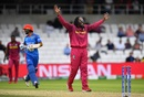 Chris Gayle played a big part in disrupting Afghanistan's chase, catching Rahmat Shah and getting Ikram Alikhil LBW, Afghanistan v West Indies. World Cup 2019, Headingley, July 4, 2019