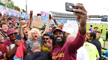 Chris Gayle takes a selfie with fans after the game
