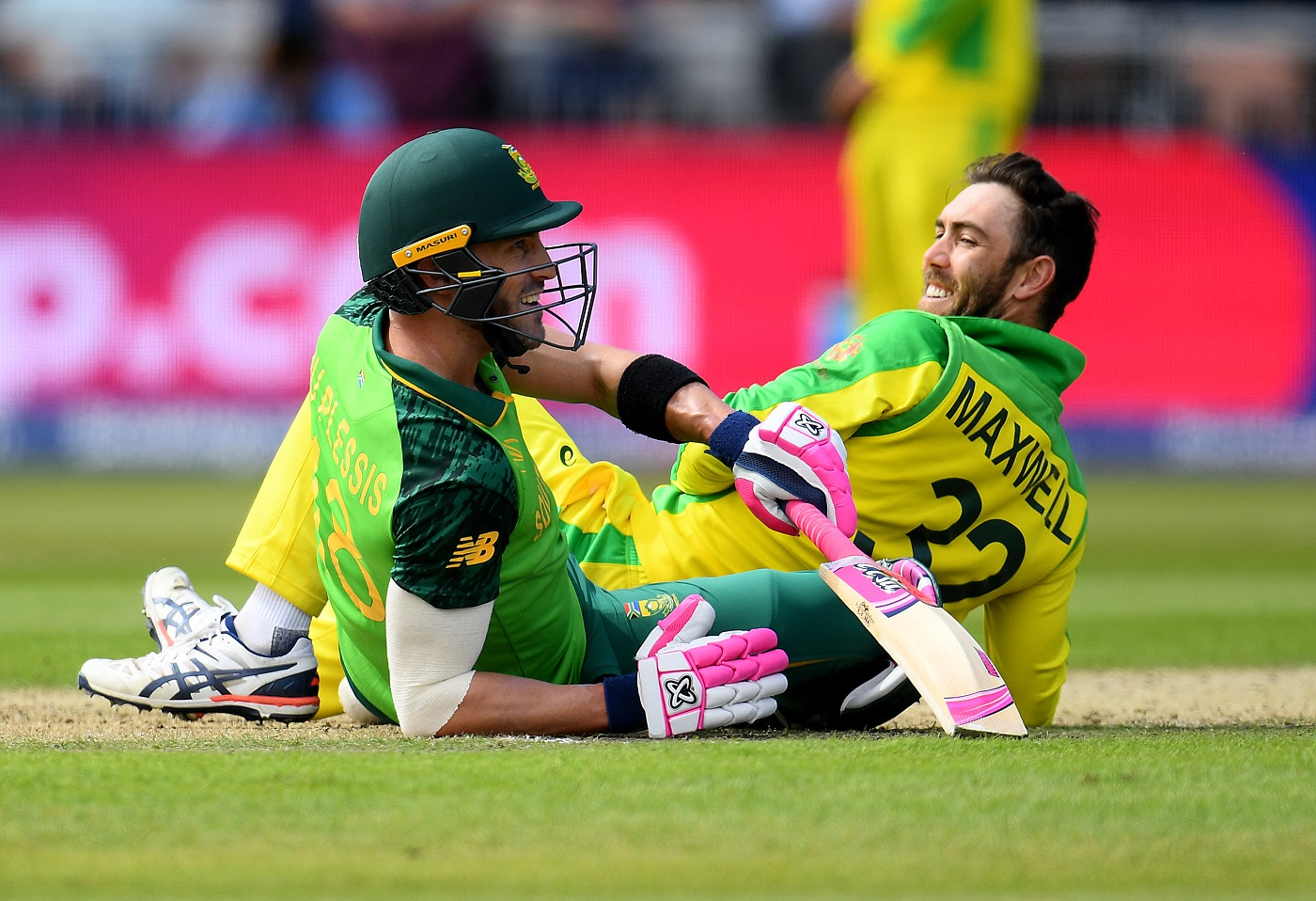 Faf du Plessis and Glenn Maxwell see the hilarity in the situation after  getting into a tangle | Photo | Global | ESPNcricinfo.com