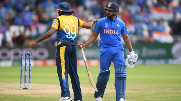 Rohit Sharma is given a pat on the back by Lasith Malinga as he walks back to the pavilion