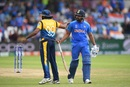 Rohit Sharma is given a pat on the back by Lasith Malinga as he walks back to the pavilion, India v Sri Lanka, World Cup 2019, Leeds, July 6, 2019