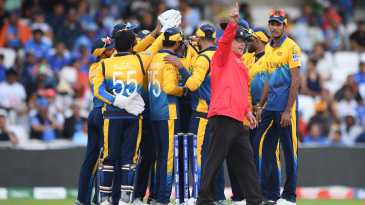 Umpire Ian Gould raises his finger one final time