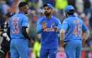 Hardik Pandya, seen here in discussion with Virat Kohli and Rohit Sharma, limped off with an injury after the 16th over, India v New Zealand, World Cup 2019, Old Trafford, July 9, 2019