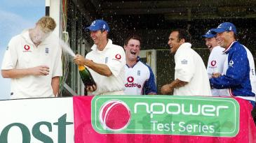 Andrew Flintoff, Michael Vaughan, Andrew Strauss, Mark Butcher, Steve Harmison and Marcus Trescothick celebrate winning the second npower Test
