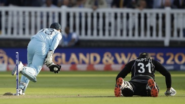 Martin Guptill falls short of his crease as Jos Buttler runs him out to crown England champions