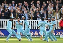 England run toward Jos Buttler as they celebrate winning the World Cup, England v New Zealand, World Cup 2019, Lord's, July 14, 2019