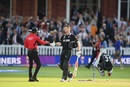 Umpire Kumar Dharmasena shakes hands with Jimmy Neesham even as Martin Guptill is on his haunches in the background, England v New Zealand, World Cup 2019, Lord's, July 14, 2019