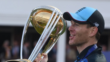 Eoin Morgan poses with the World Cup trophy
