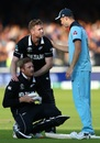 Chris Woakes consoles Jimmy Neesham and Martin Guptill after England sealed a thrilling Super Over, England v New Zealand, World Cup 2019 final, Lord's, July 14, 2019