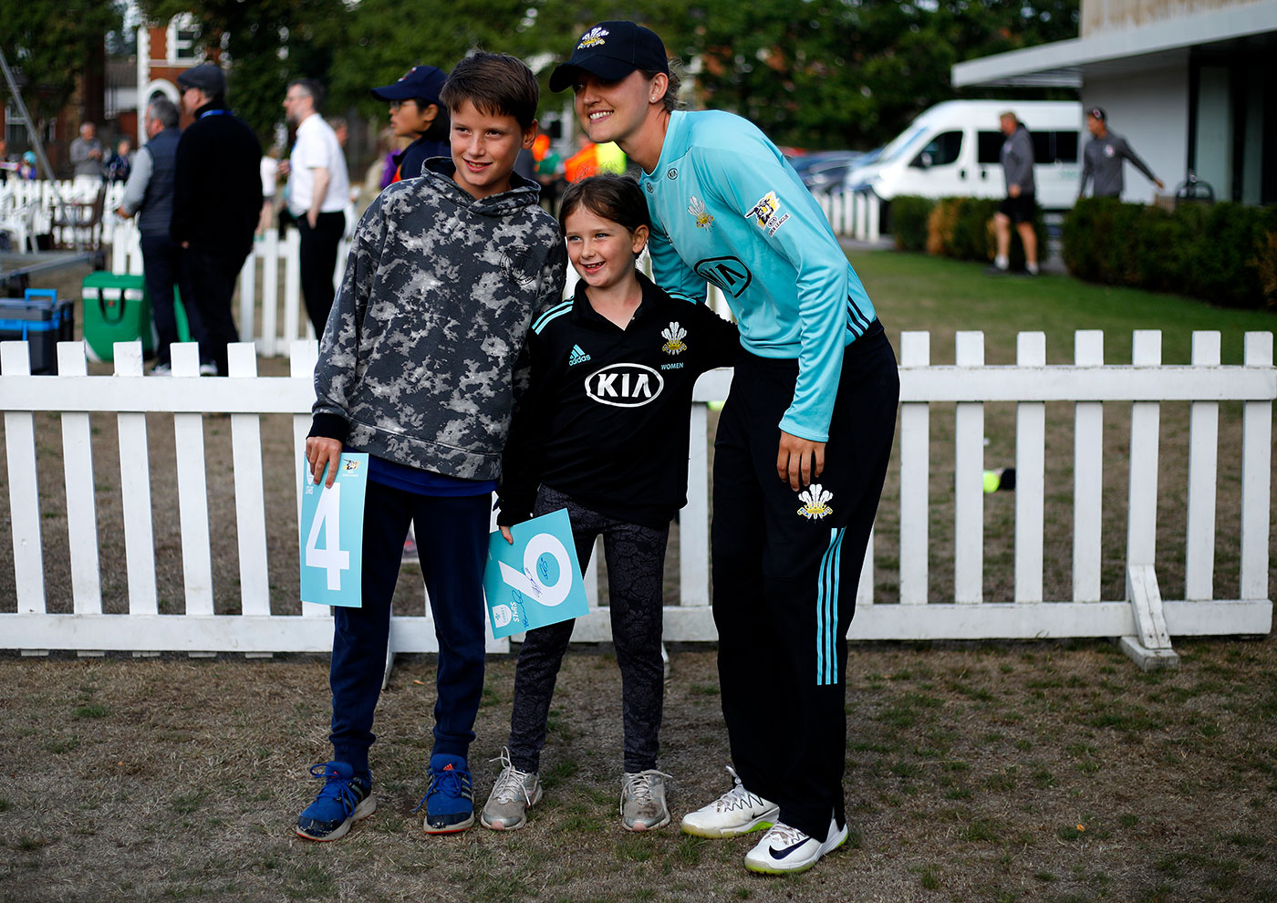 Taylor poses with young fans during a Kia Super League game