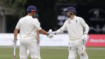 Sam Hain of England Lions is congratulated for his fifty by Sam Curran (right)
