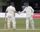 Sam Hain of England Lions is congratulated for his fifty by Sam Curran (right), England Lions v Australians, Tour match, Canterbury, 4th day, July 17, 2019