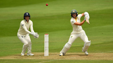 Ellyse Perry drives through the covers