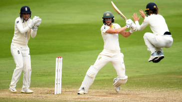 Amy Jones takes evasive action as Ellyse Perry drives