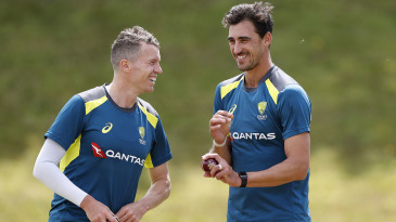 Mitchell Starc and Peter Siddle share a laugh