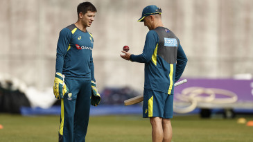 Tim Paine and Brad Haddin chat during a net session