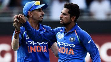 Yuzvendra Chahal and Kuldeep Yadav celebrate a wicket