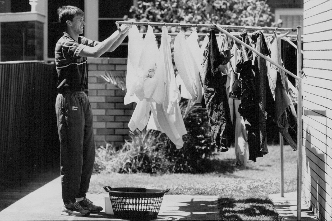 Of humble beginnings are monsters made: McGrath hangs up the washing after hearing of his call up for Australia, back in 1993